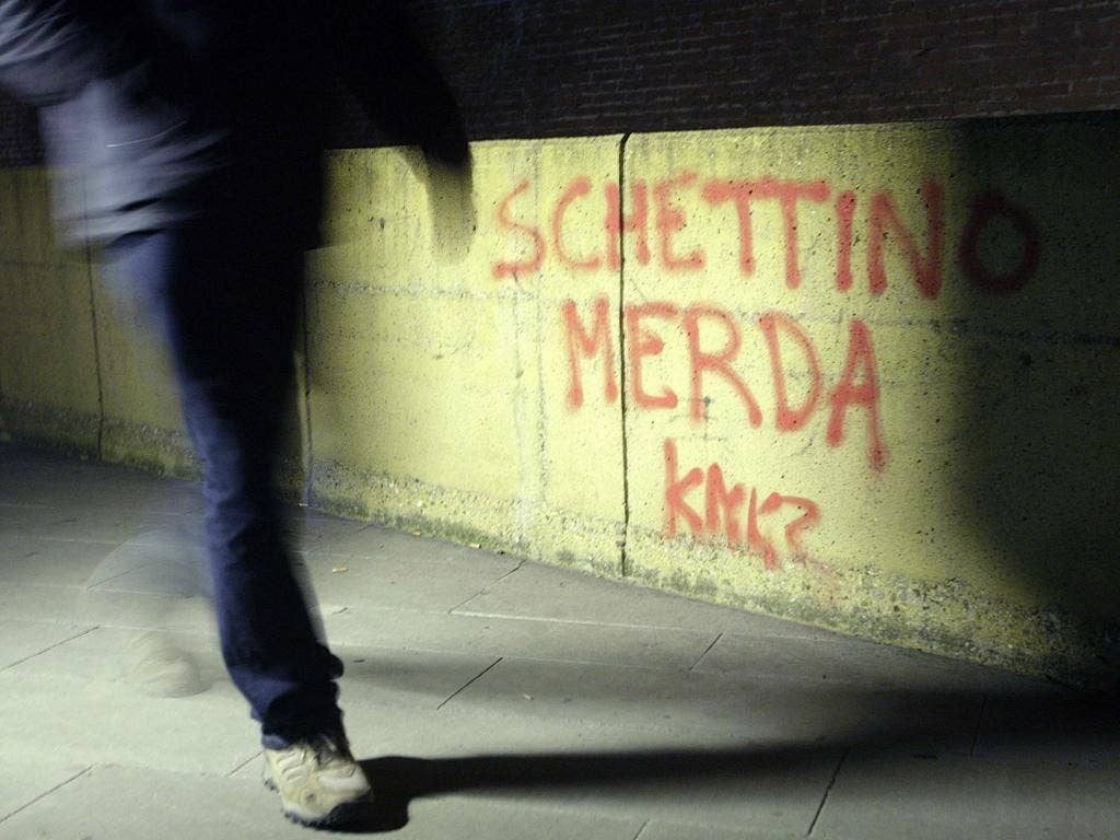 Graffiti outside an Italian prison reads: 'Schettino shit'