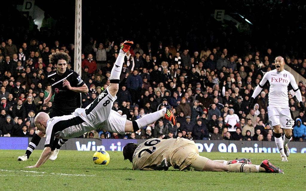 Andy Johnson is sent tumbling by goalkeeper Tim Krul, which led to Fulham's second penalty