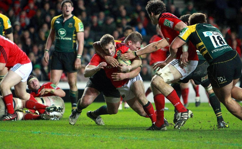 Tomas O'Leary of Munster tests the Northampton defence in Milton Keynes