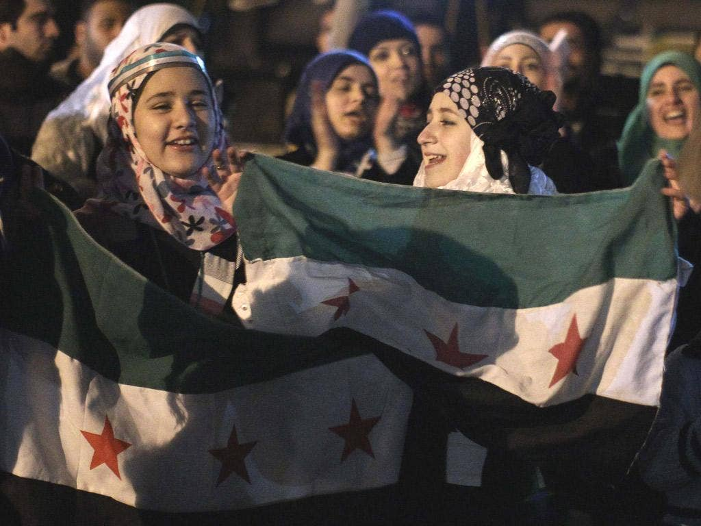 Syrian women protest outside the Arab League building yesterday in Cairo