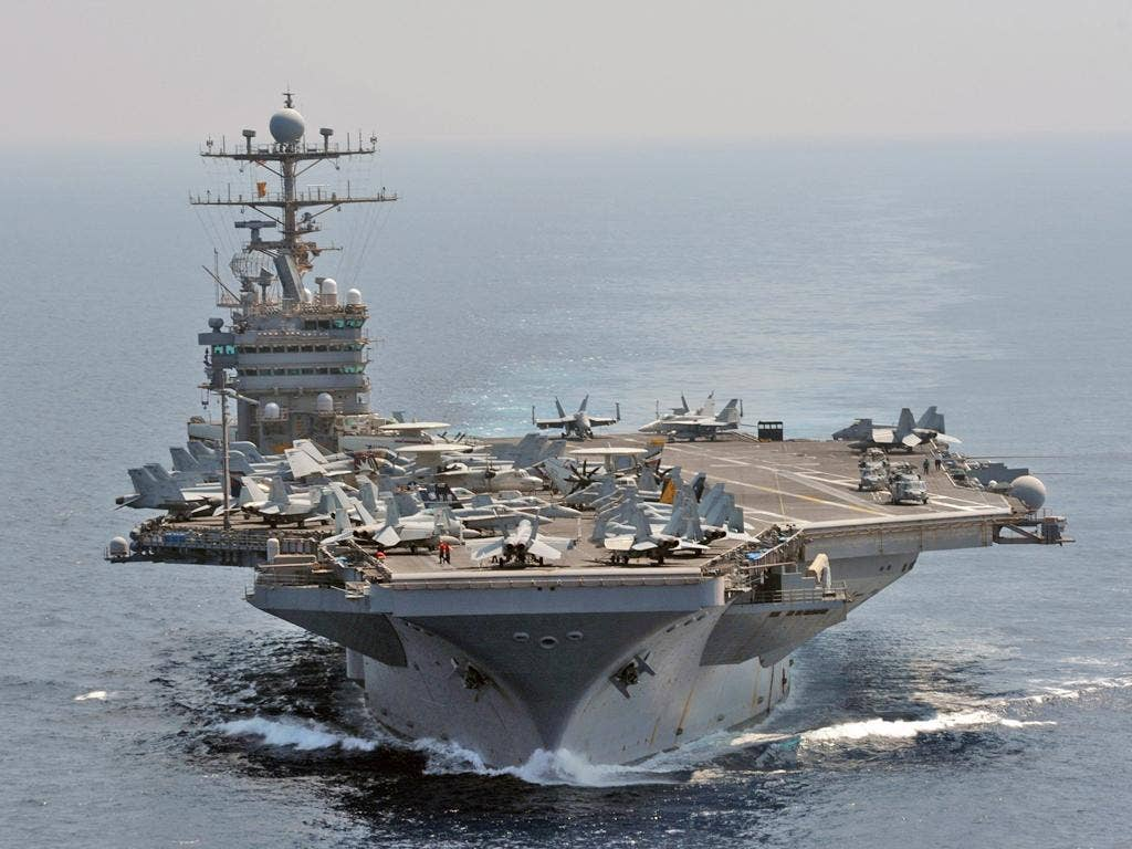 The USS Abraham Lincoln sailed through the Strait of Hormuz and into the Gulf without incident, after Iran backed away from an earlier threat to take action if an American carrier returned to the strategic waterway