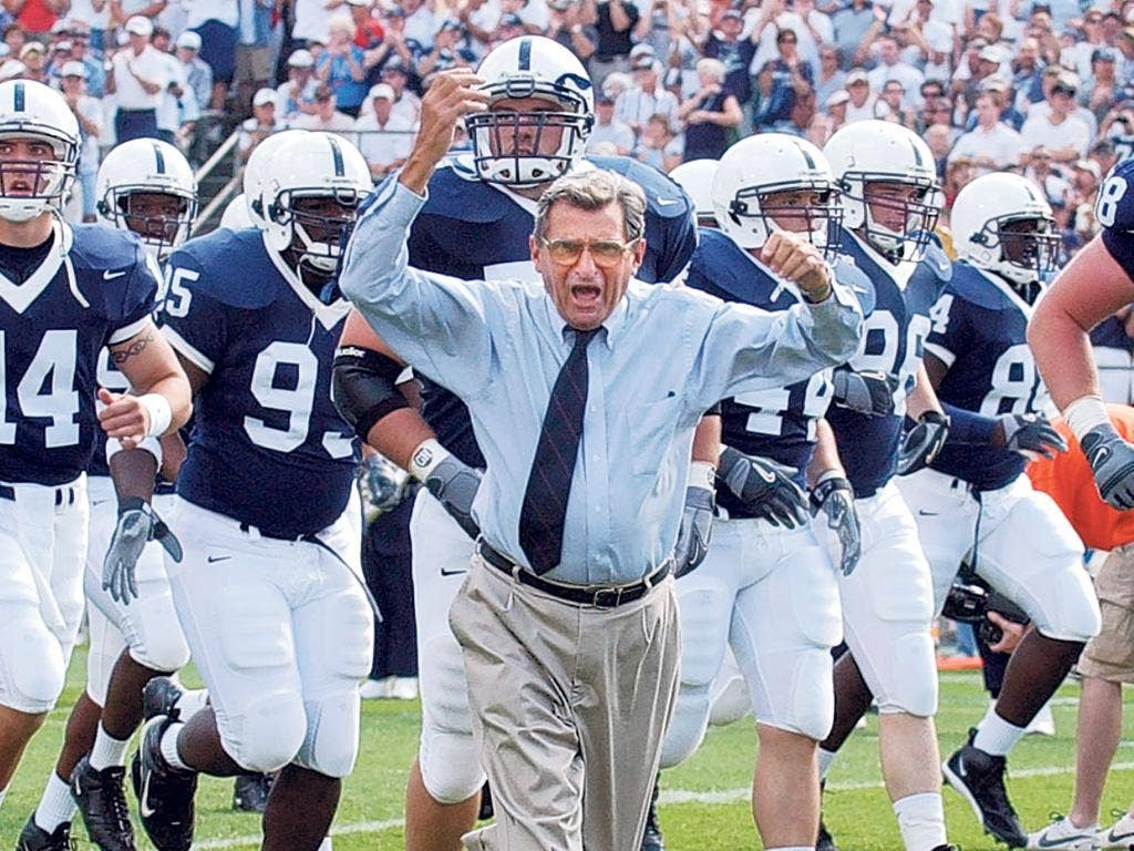 Inspirational: Paterno with his Penn State side in 2004; he also tried to ensure that all his charges graduated