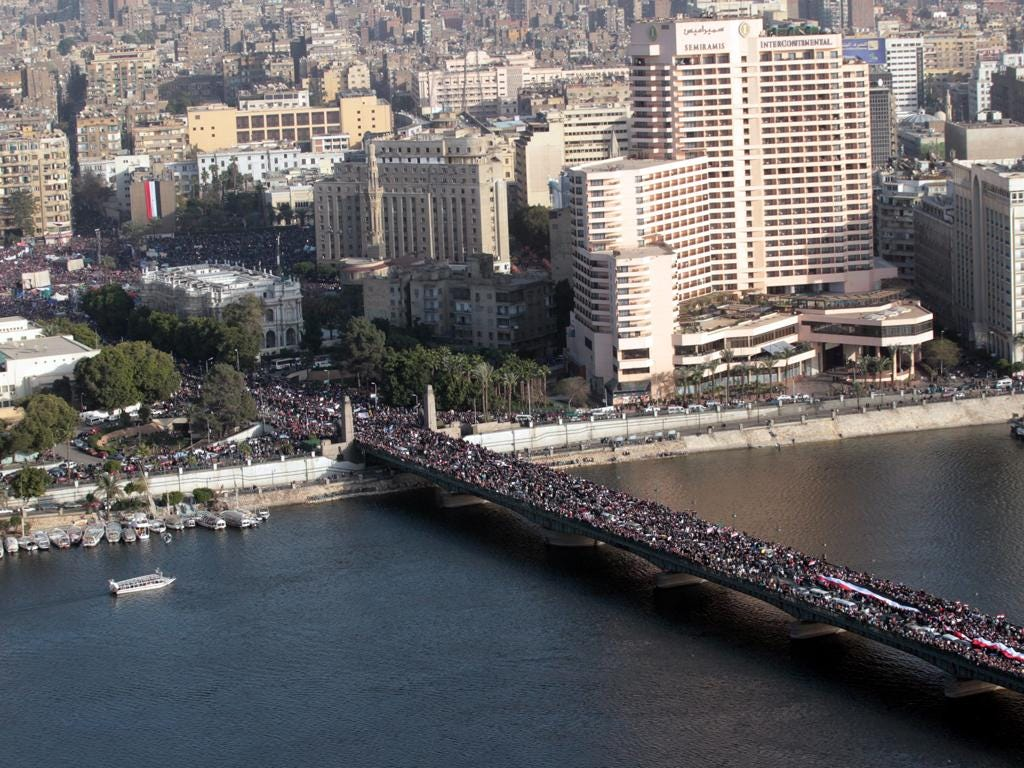 Protesters celebrate the one year annivesary of the 25th January uprising in Cairo