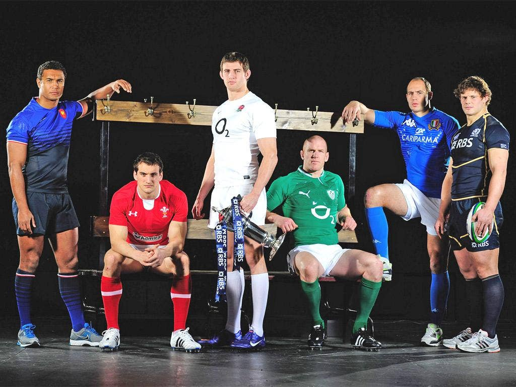 England's Tom Wood poses holding the Six Nations trophy with the rugby captains of the other competing nations including; Thierry Dusautoir of France, Sam Warburton of Wales, Paul O'Connell of Ireland, Sergio Parisse of Italy and Ross Ford of Scotland