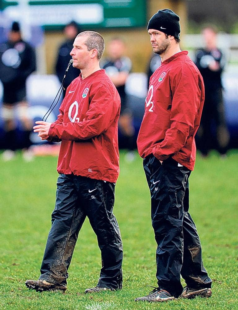England coaches Andy Farrell (right) and Stuart Lancaster watch a training session in Leeds yesterday