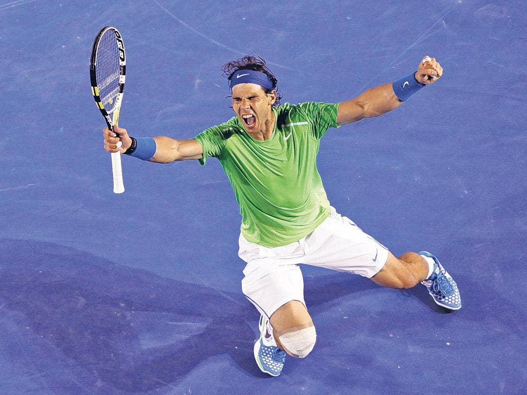 Rafael Nadal celebrates his win over Roger Federer