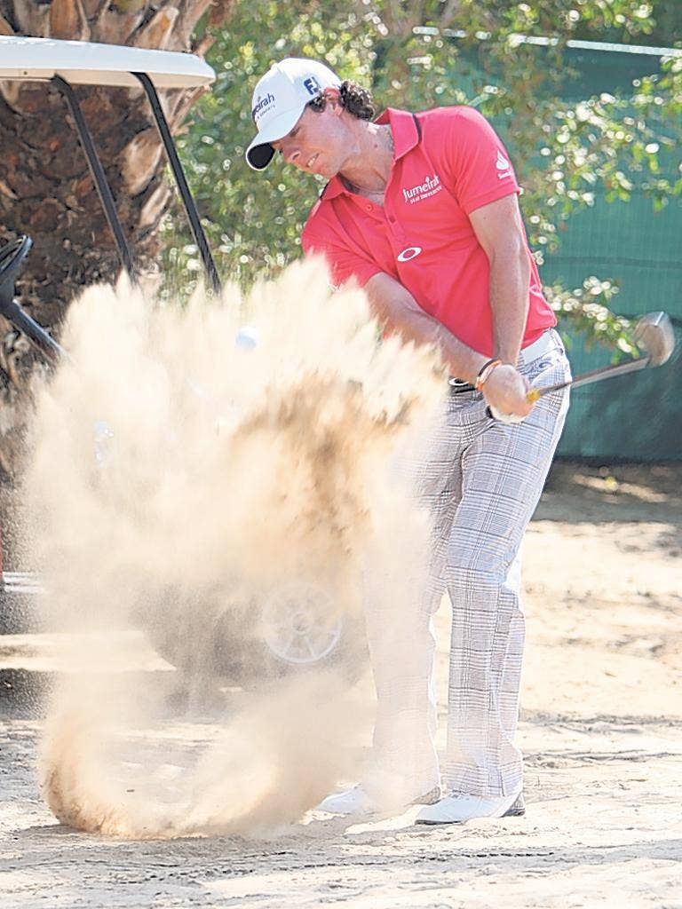 Rory McIlroy picked up a two-shot penalty for breaking a bunker rule