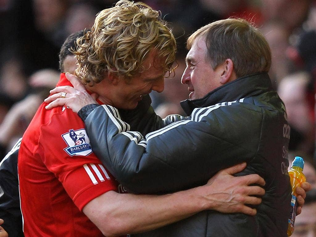 Liverpool Manager Kenny Dalglish embraces Dirk Kuyt at the end of the FA Cup Fourth Round match between Liverpool and Manchester United