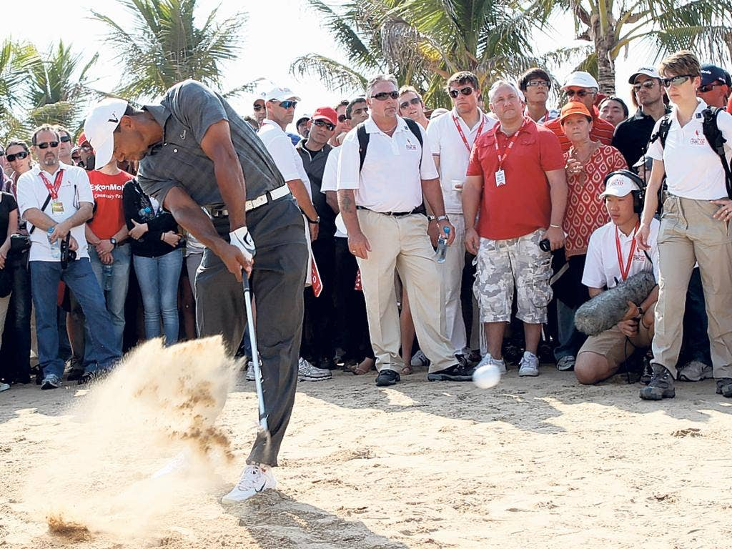 Swingtime: Tiger Woods on his way to a six-under-par 66 in the third round of the Abu Dhabi Championship yesterday