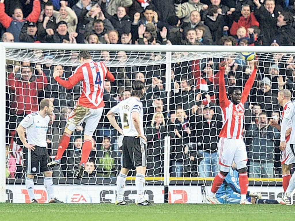 Decider: Robert Huth (second from left) scores Stoke's second at Derby
