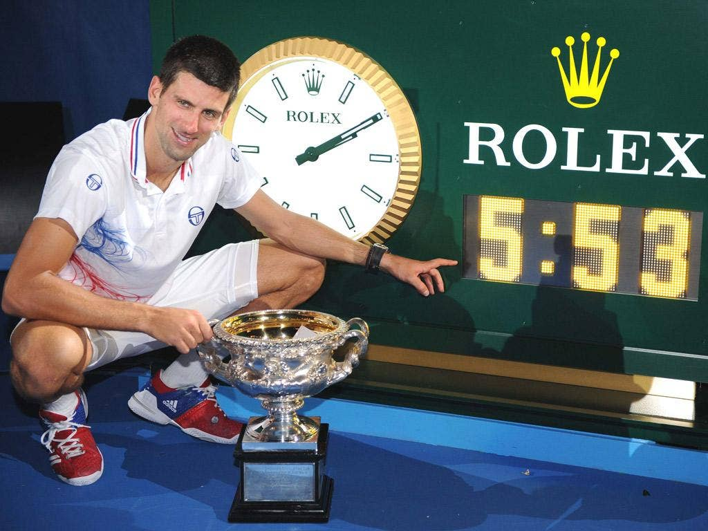 Novak Djokovic can finally afford to smile after a punishing five hours and 53 minutes on court with Rafa Nadal that earned him his third Australian Open title last night
