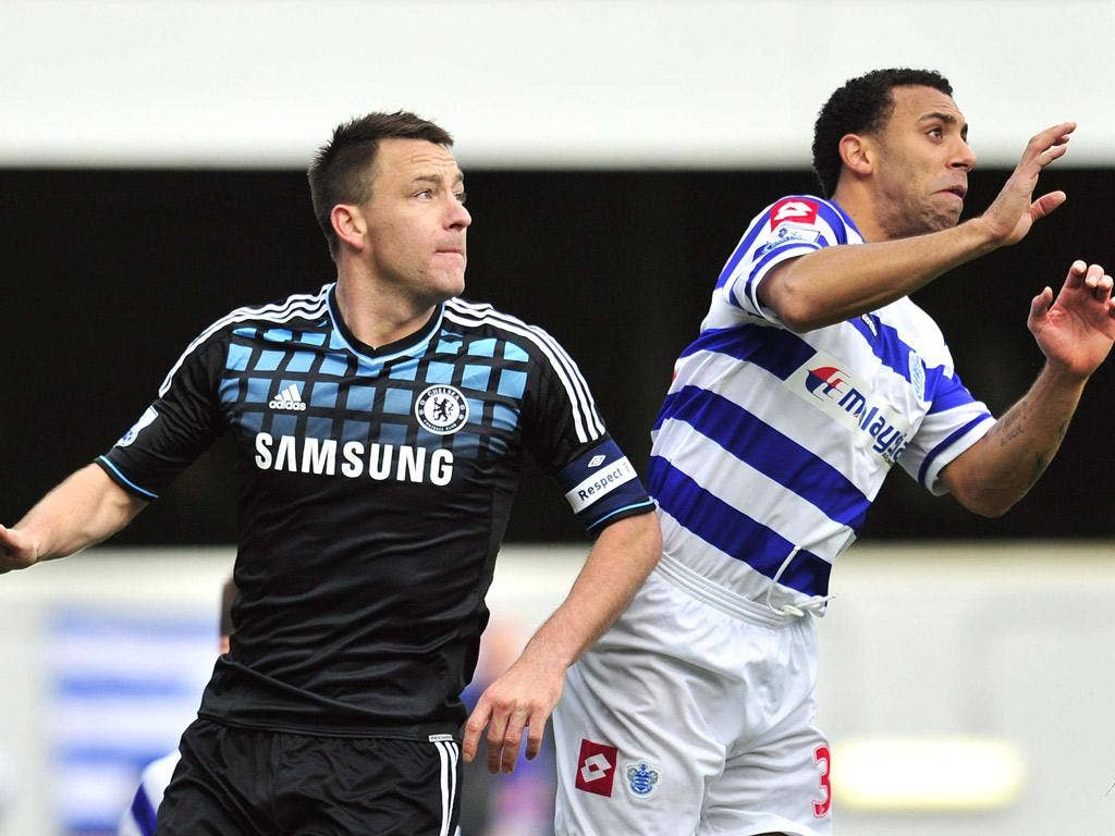 John Terry challenges Anton Ferdinand for the ball on Saturday