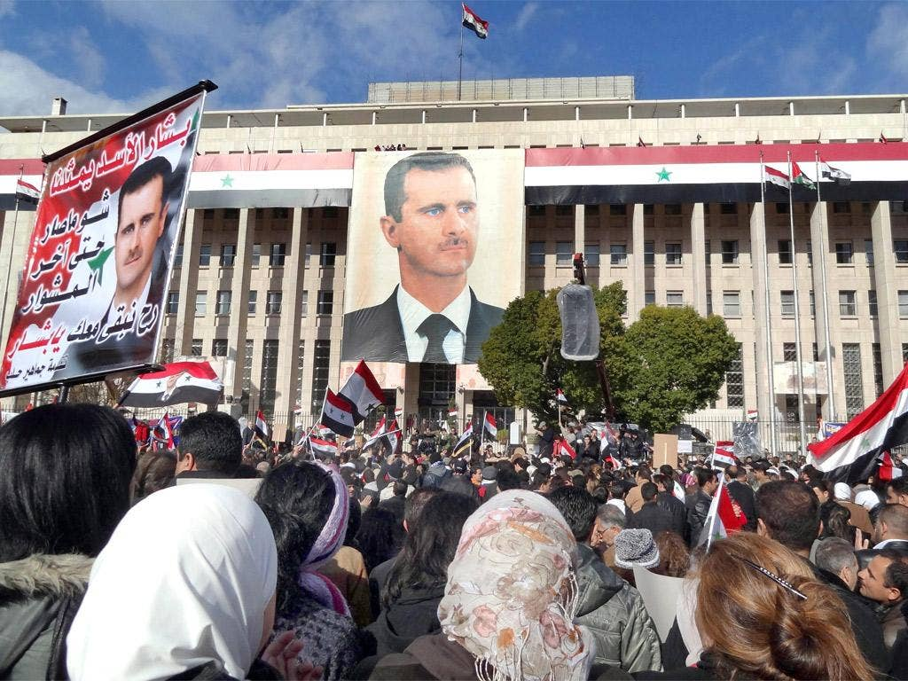Supporters of President Bashar Assad at a rally in Sabe Bahrat square, Damascus
