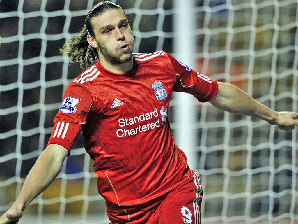 Andy Carroll wheels away after putting Liverpool on their way to a win at Wolves