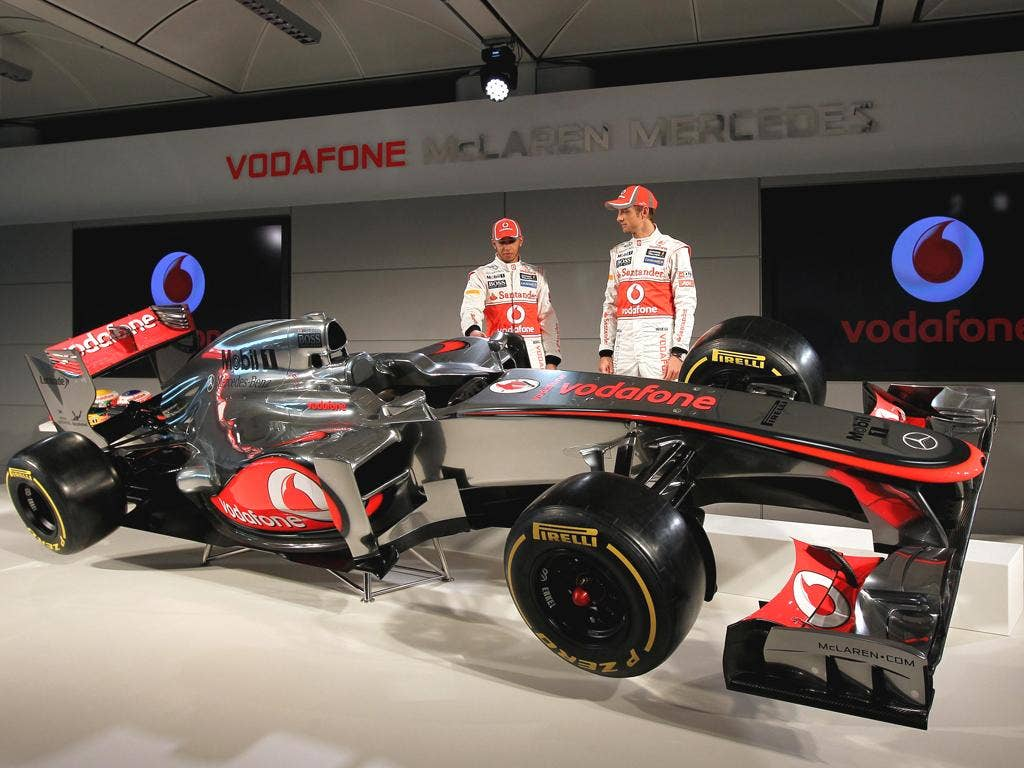 Lewis Hamilton and Jenson Button admire the new MP4-27 McLaren for the coming season