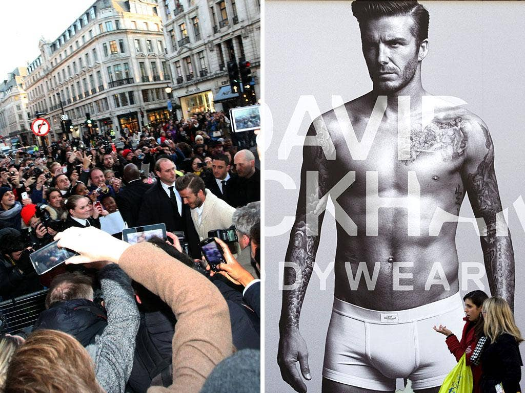 Hundreds of fans gave David Beckham (and his pants, right) a rapturous reception in Regent Street yesterday