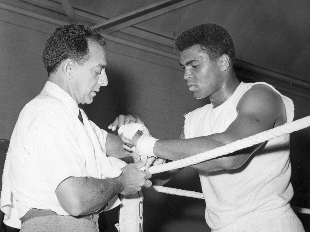 Dundee tends to Muhammad Ali in the run-up to the fight against Henry Cooper at Highbury in 1966