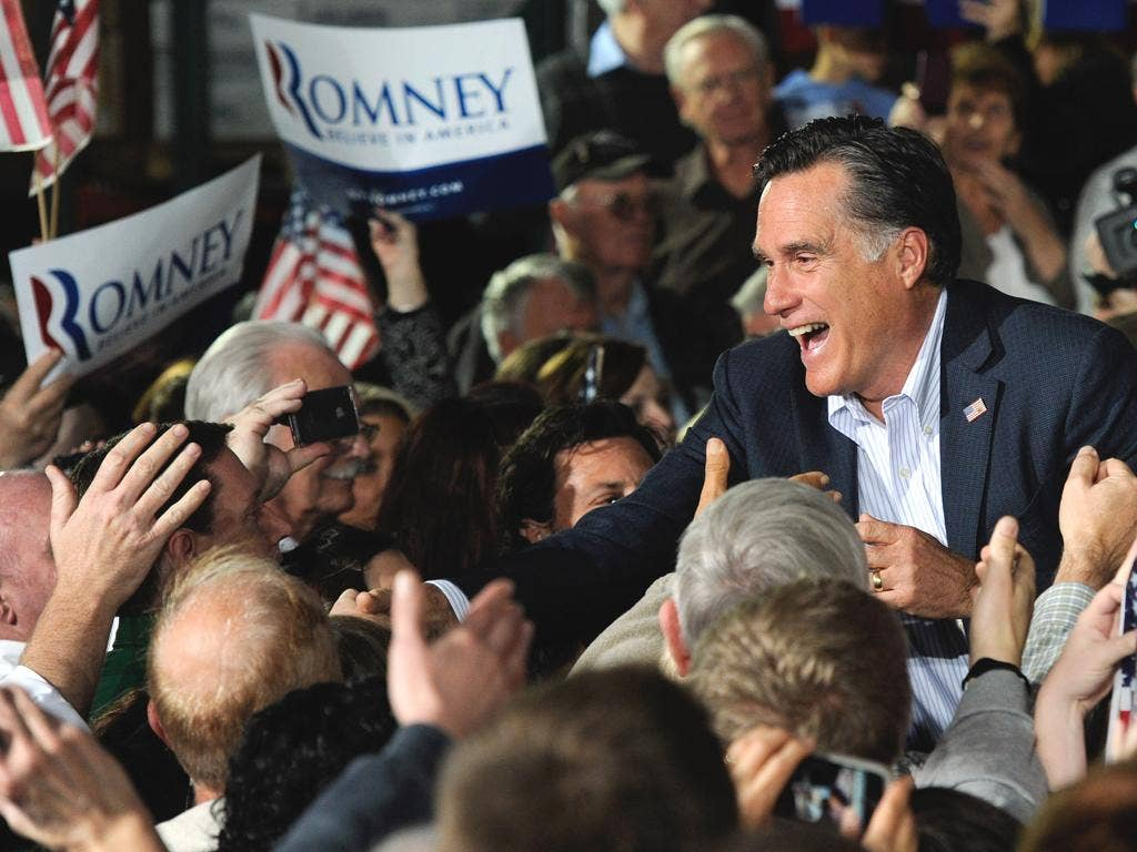 Mitt Romney greets supporters during a rally at Brady Industries in Las Vegas