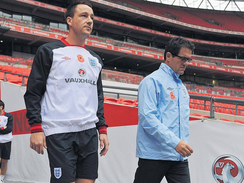 Fabio Capello (right) must select a new captain to replace John Terry