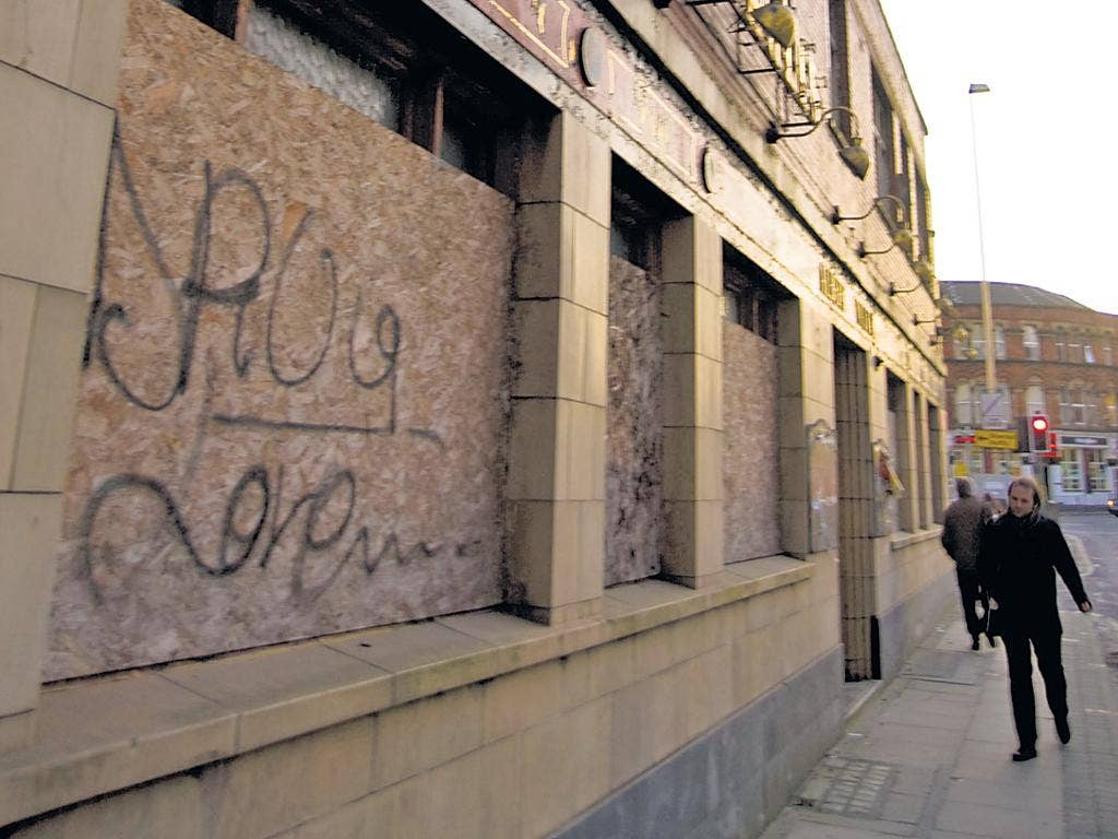 The graffiti-covered Albert Vaults in Manchester's Chapel Street has been closed and boarded up since 2009