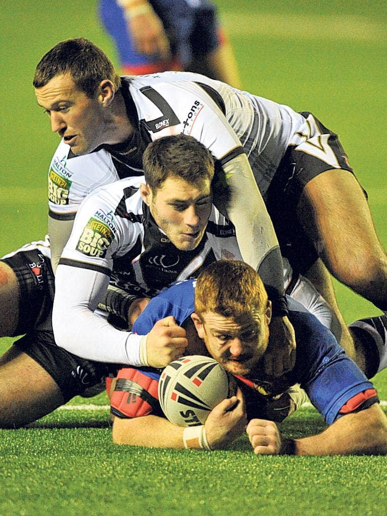 Wakefield's Steve Southern is stopped by the Widnes defence last night