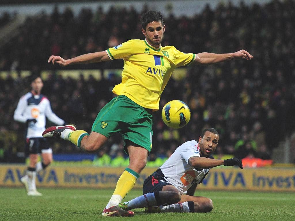 Andy finish: Andrew Surman puts Norwich ahead while Simeon Jackson (right) braves the Norfolk chill