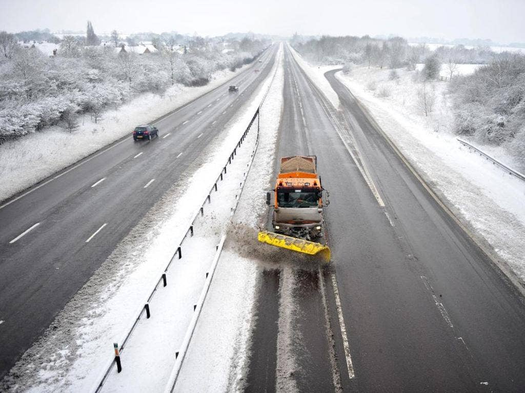 Many motorway drivers were forced to spend the night in their cars as the snow brought traffic to a standstill on the M25, while Heathrow Airport cancelled a third of its flights.