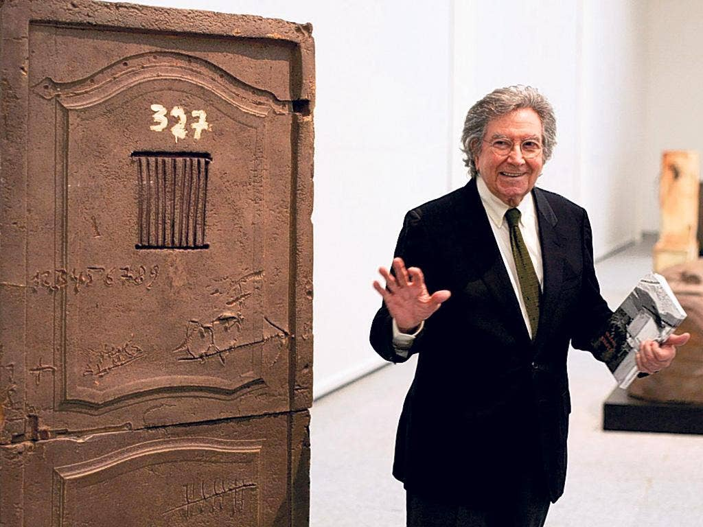 Tapies next to one of his pieces during an exhibition of his work in Madrid in 2004