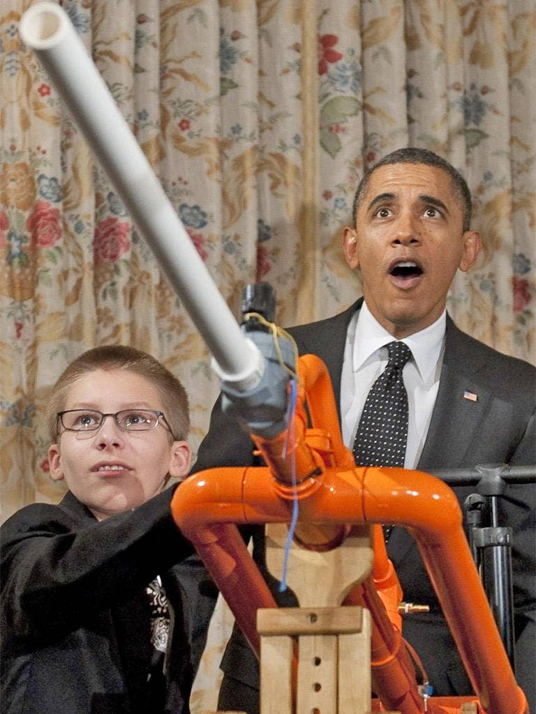 Barack Obama reacts after firing 14-year-old Joey Hudy's 'Extreme Marshmallow Cannon' during a science fair at the White House yesterday. The President announced new policies to recruit and support science teachers