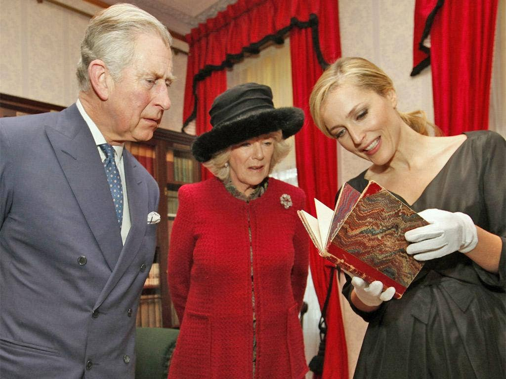 Charles and Camilla with the actress Gillian Anderson