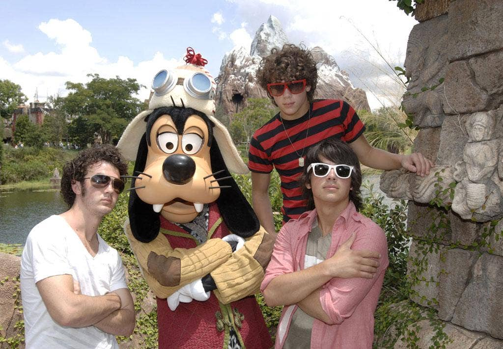 The Jonas Brothers with Goofy at Walt Disney's Animal Kingdom Theme Park in Florida