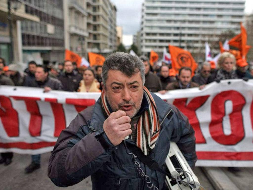 Employees of the Public Power Corporation protest over plans for privatisation in Athens yesterday