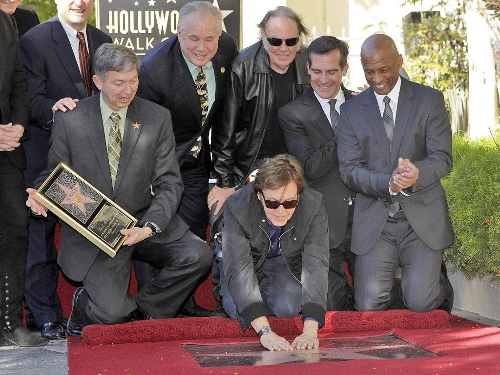 Sir Paul McCartney unveils his own star on the Hollywood Walk of Fame
