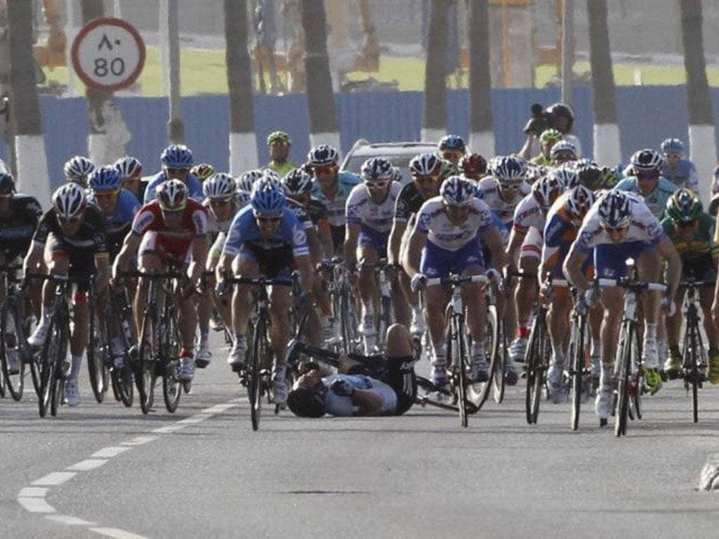 Mark Cavendish tumbles out on stage six yesterday