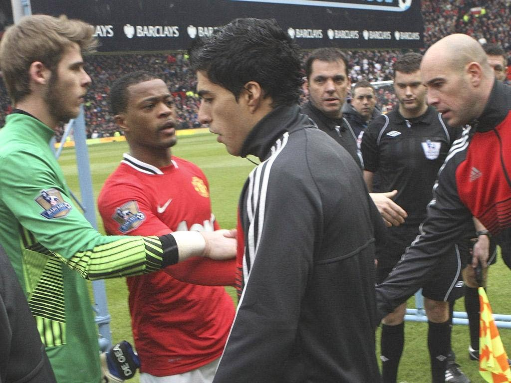 Handbags, no handshakes: Suarez refuses to shake Evra's hand