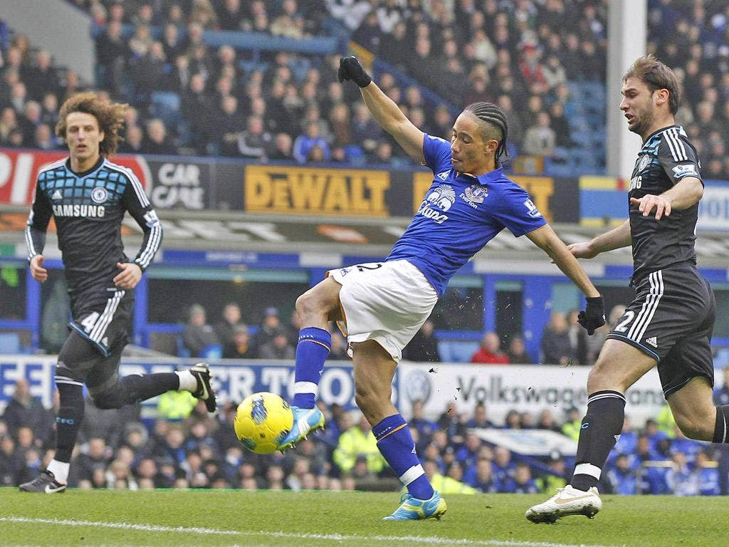 Sweet for Toffees: Steven Pienaar scores Everton's first goal during their stunning win over Chelsea