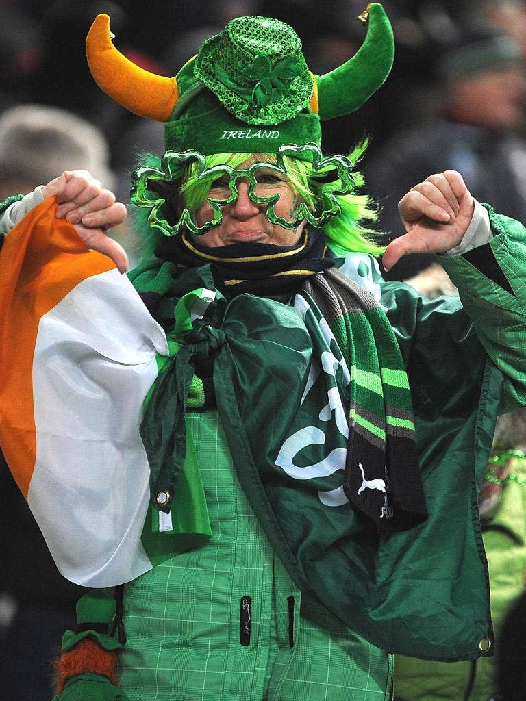 An Irish fan gives the thumbs down after the France-Ireland match was postponed just before kick-off on Saturday at the Stade de France