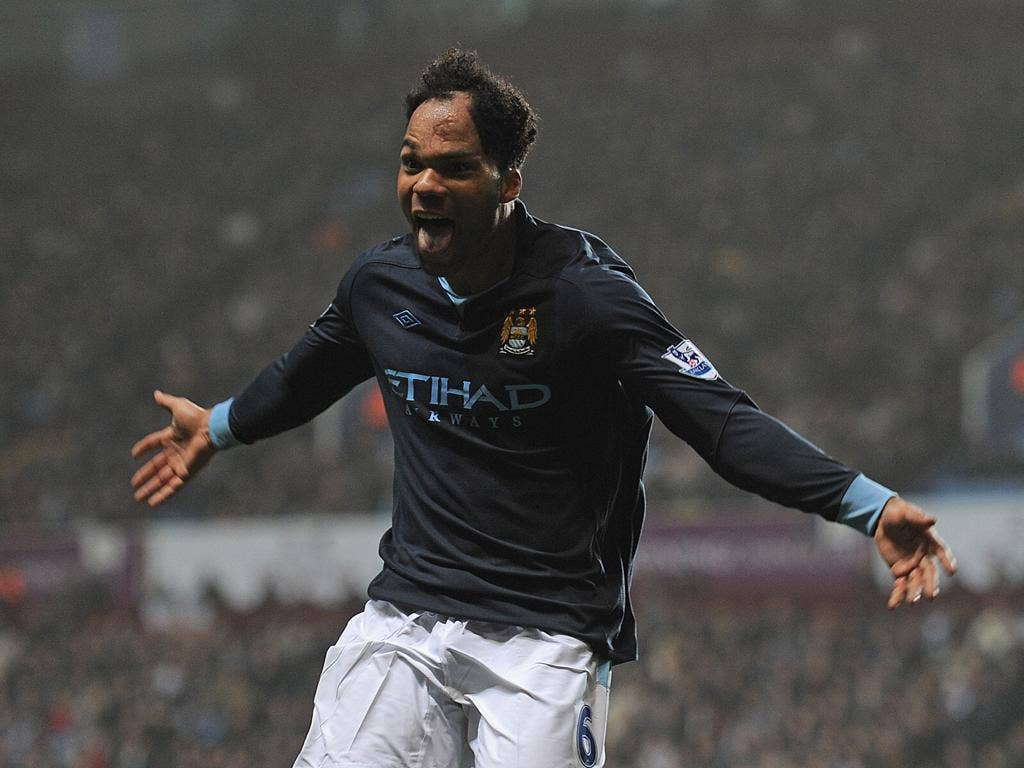 Joleon Lescott celebrates after scoring the only - and winning - goal for Manchester City against Aston Villa
