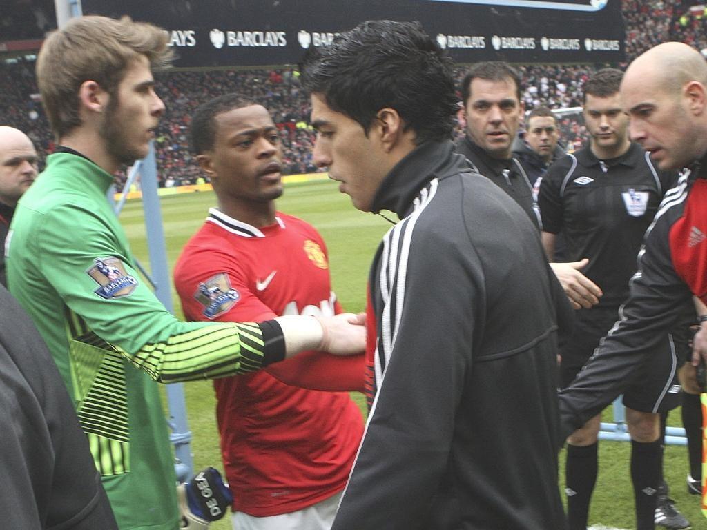 Liverpool's Luis Suarez refuses to shake Patrice Evra's hand