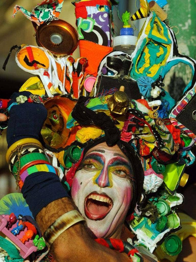 A reveler performs during the Banda de Ipanema carnival street band parade along in Rio de Janeiro