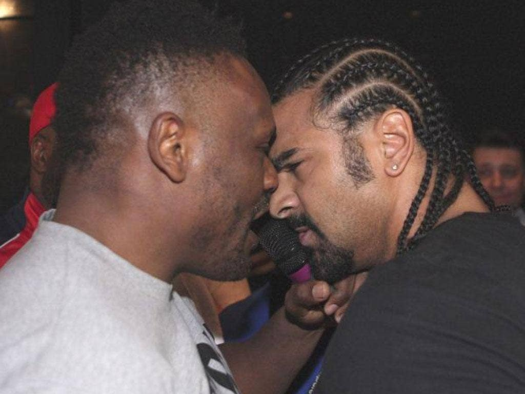 Dereck Chisora and David Haye square up before fighting breaks out