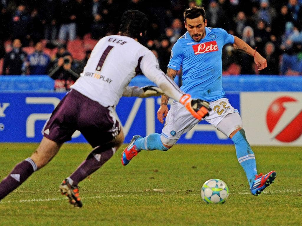 Petr Cech scrambles but can't prevent Lavezzi scoring Napoli's third