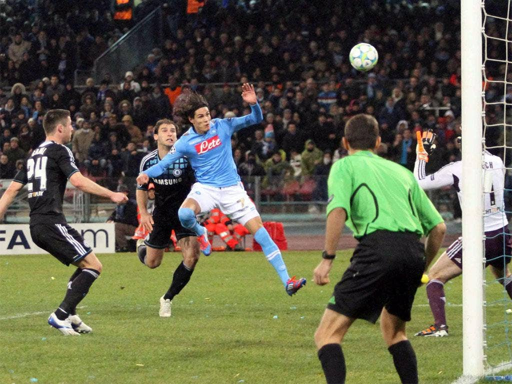 Napoli's Uruguayan forward Edinson Cavani puts the hosts ahead with a goal which went in off his shoulder