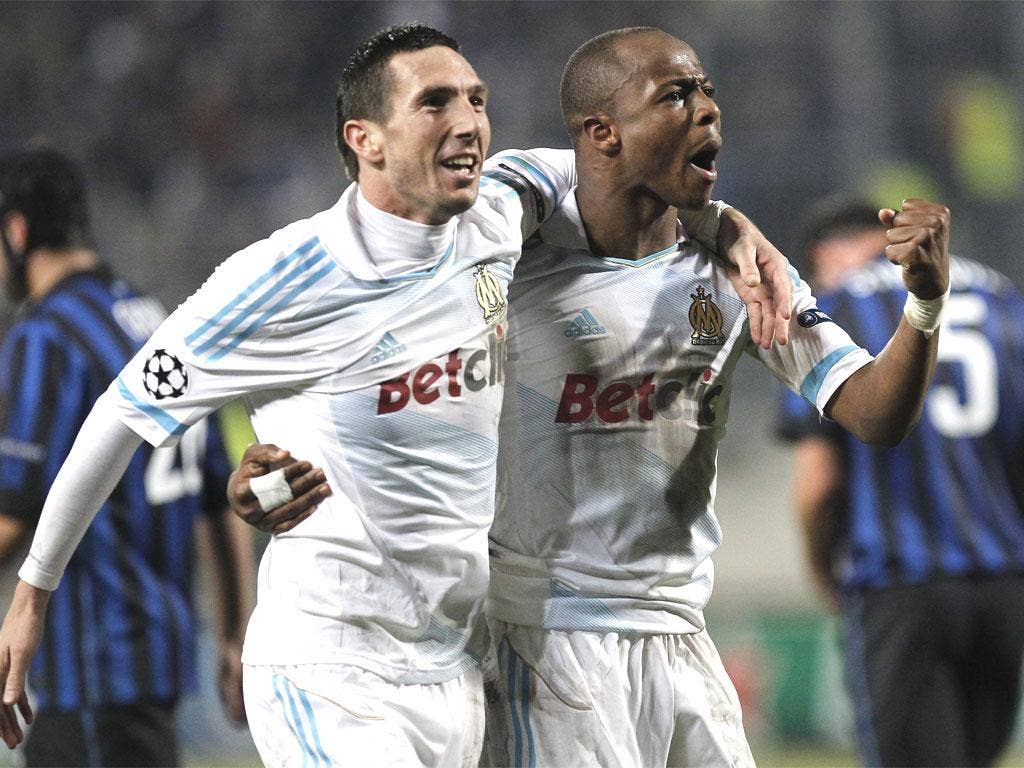 Marseille's Andre Ayew, right, celebrates his goal with Morgan Amalfitano