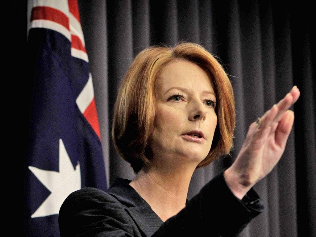 Australia's Prime Minister, Julia Gillard, said she would give up leadership ambitions if Labor politicians backed Kevin Rudd in Monday's vote