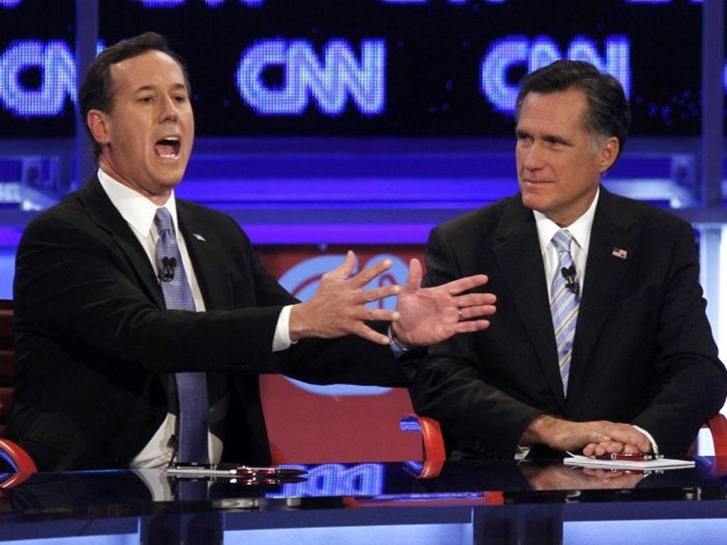 Rick Santorum, left, makes his voice heard in the Arizona debate