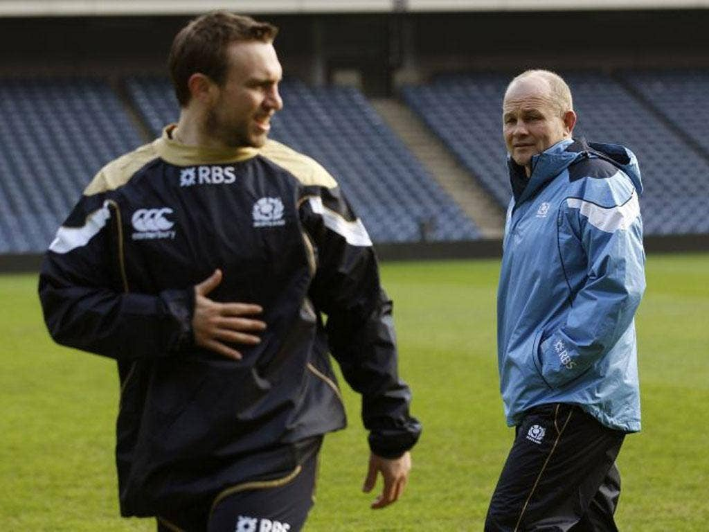 Coach Andy Robinson looks on as Mike Blair takes part in Scotland training