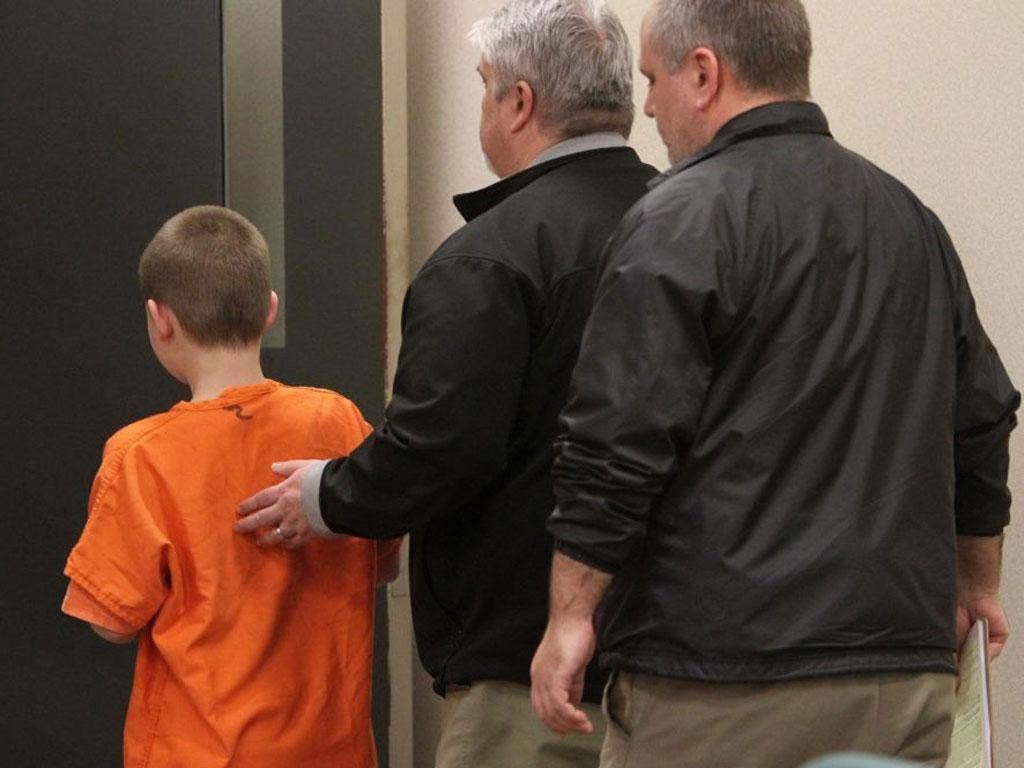The boy appears at a juvenile court in Port Orchard, Washingston state accompanied by his family