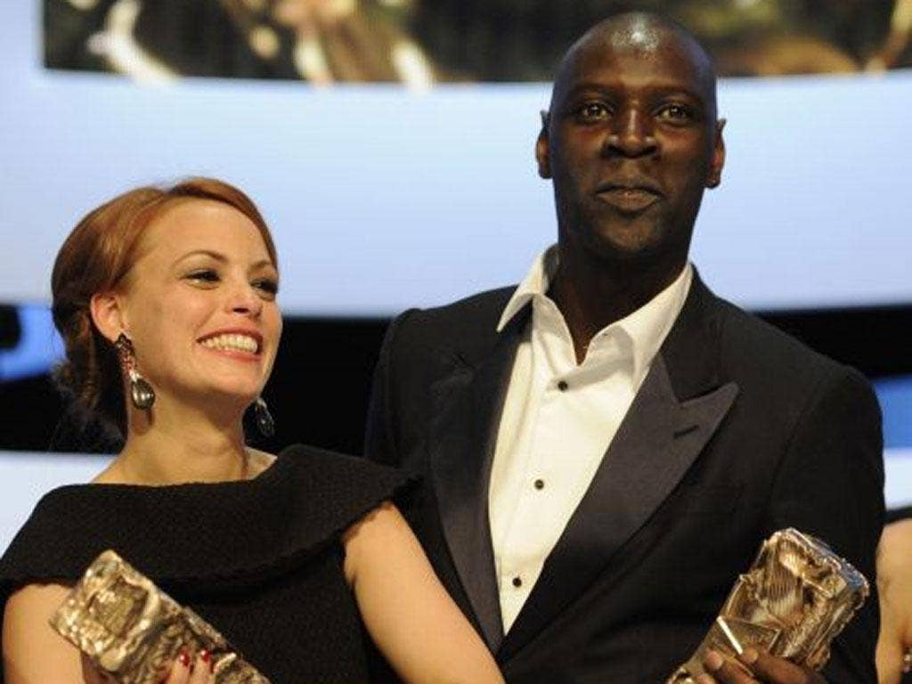 Omar Sy, star of Intouchables, right, is the first black person to receive the Best Actor award. He is pictured with Bérénice Bejo with her Best Actress César for The Artist