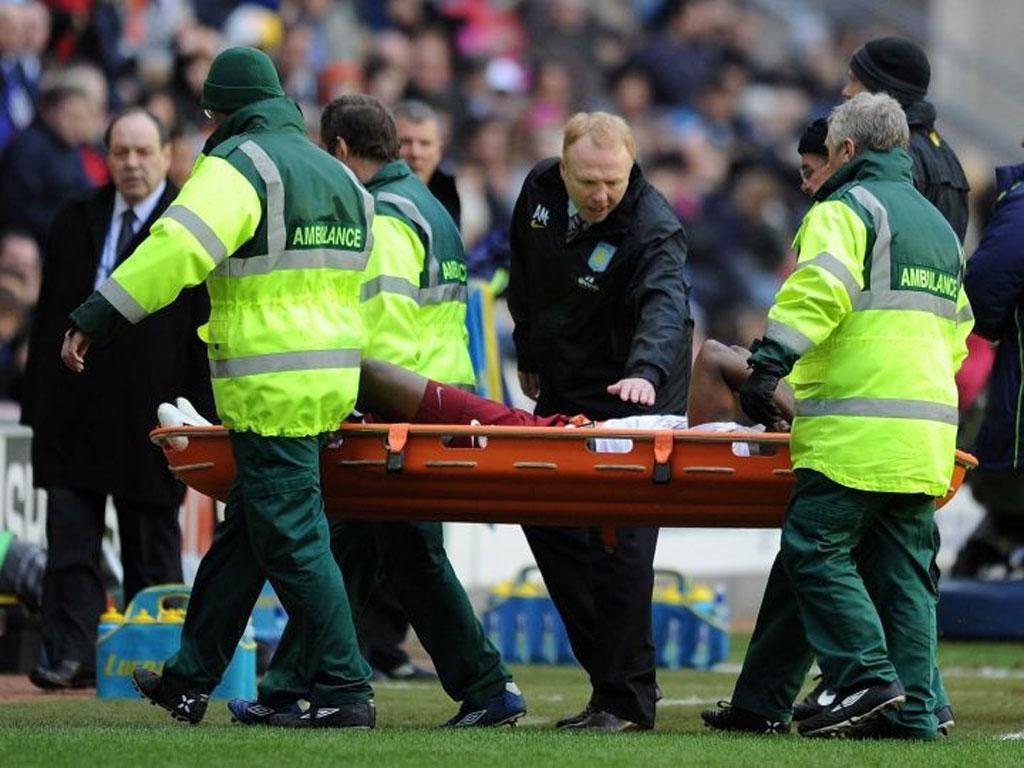 Alex McLeish looks concerned as Villa's Darren Bent is stretchered off